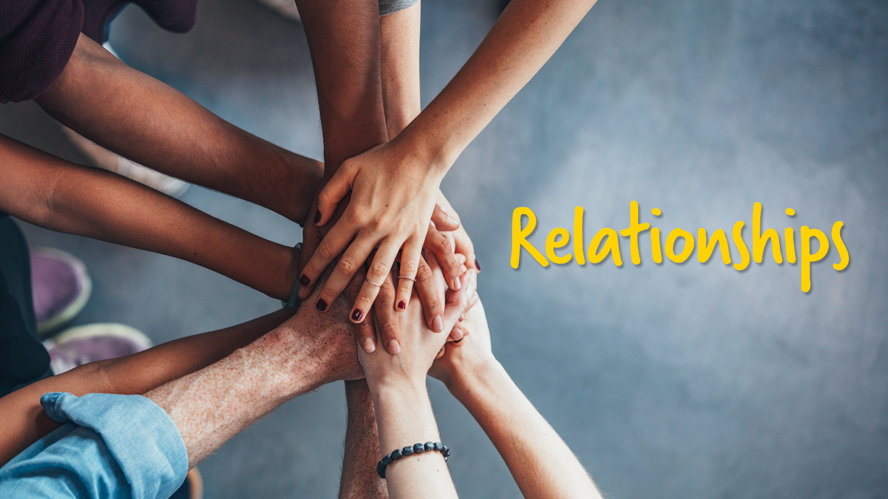 An image of hands together in a group with the word 'relationships' beside it
